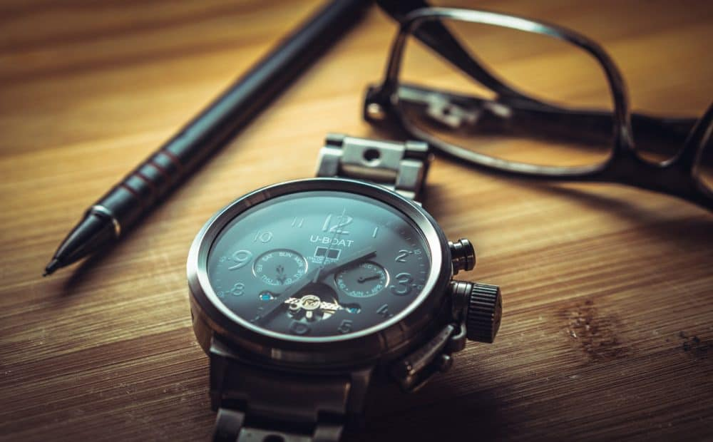 watch, pen and glasses